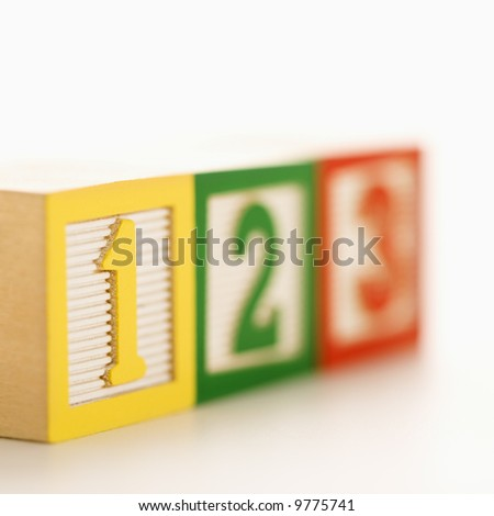 Selective focus of toy building blocks with numbers.