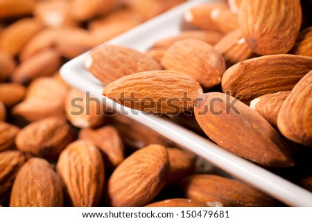 Selective focus on almond in the middle  - stock photo