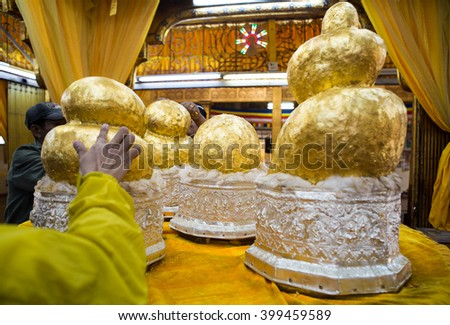 Selective focus on center of Five Gilded Buddha image statues at Phaung Daw Oo pagoda in Inle Lake, Shan State, Myanmar - stock photo