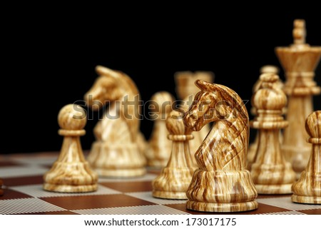 selective focus on chess horse on black background - stock photo