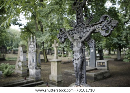 Selective focus on cross on the grave, Prague - stock photo
