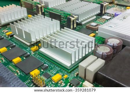 Selective Focus On Electronic Board With Big Heatsinks - stock photo