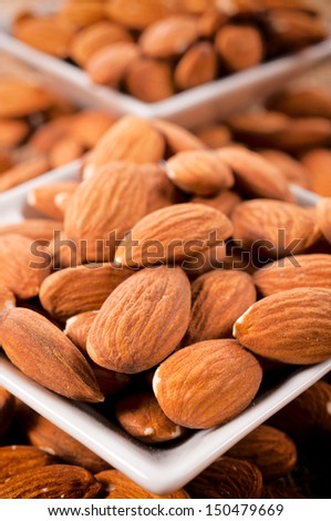 Selective focus on front almonds  in the white cup - stock photo