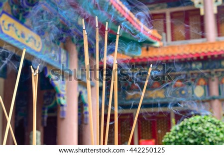 Selective focus on front of josssticks, Incense sticks are burning with smoke use for pay respect to the Buddha  - stock photo