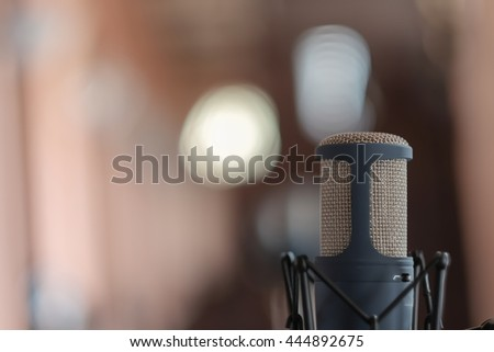 selective focus on microphone conference in the center with blurry background for text  - stock photo