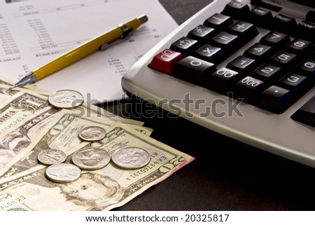 Selective focus on paper currency with adding machine, financial statement and yellow pencil