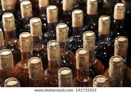 selective focus on the  bottles of wine - stock photo