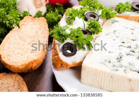 Selective focus on the bruschetta with olive - stock photo