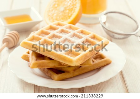Selective focus on the front Belgium waffles in plate  - stock photo