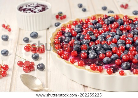 Selective focus on the front berry fruit on tart cake  - stock photo