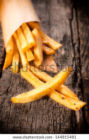 Selective focus on the front french fries on wooden table - stock photo
