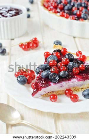 Selective focus on the front slice of tart cake with berry fruit - stock photo