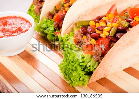 Selective focus on the front taco sandwich - stock photo
