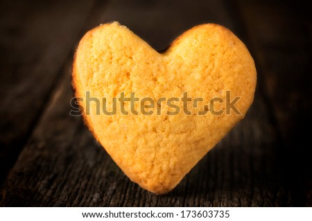 Selective focus on the heart shape cookies on the wooden background - stock photo