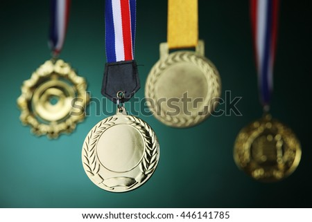 selective focus on the medal in front of blackboard - stock photo