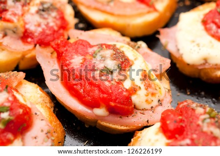 Selective focus on the melted cheese and tomato - stock photo