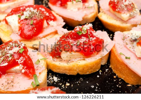 Selective focus on the middle bruschetta - stock photo
