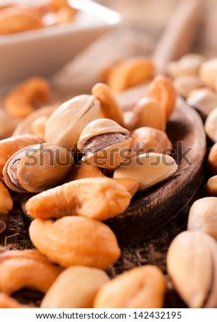 Selective focus on the pistachio on ladle - stock photo