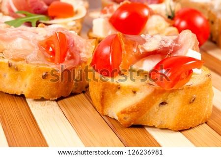 Selective focus on the right bruschetta - stock photo