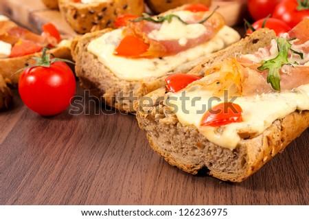 Selective focus on the right Italian sandwich - stock photo