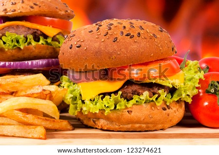 Selective focus on the right small cheeseburger - stock photo