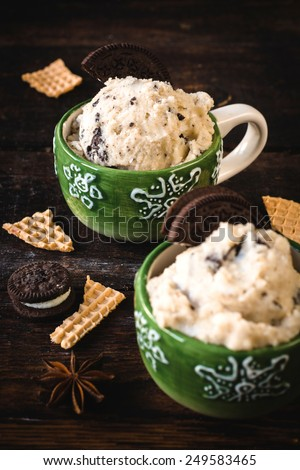 Selective focus on the second ice cream with cookies in cup  - stock photo