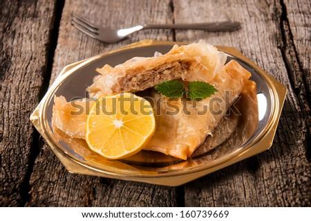 Selective focus on the top sliced baklava cake - stock photo