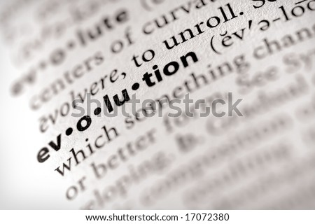"""Selective focus on the word """"evolution"""". - stock photo"""