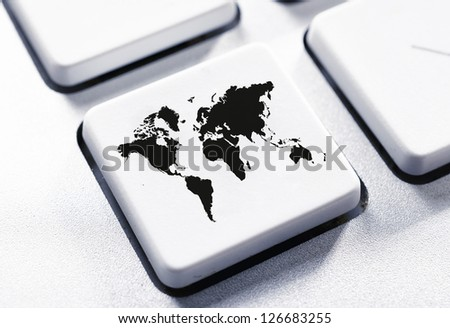 Selective focus on the world map button - stock photo