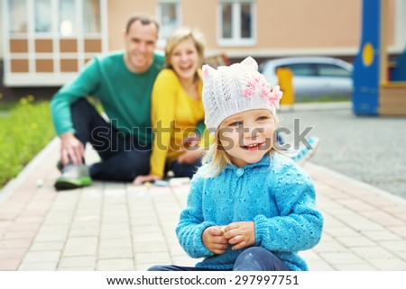 selective focus. outdoor playing family. young parents with a baby for a walk in the summer. Mom, dad and child - stock photo
