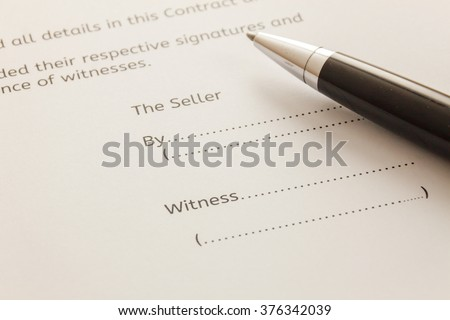 selective focus pen on contract for deed form background. - stock photo