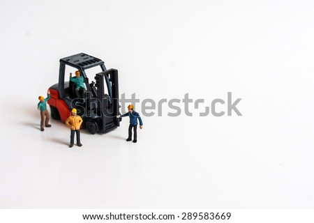 selective focus photo of miniature business man with casual spilled from pill bottle on white background, abstract background to medical concept - stock photo