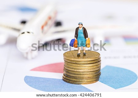selective focus photo of miniature woman with shopping bag on 50 cent euro coins over report  chart background, abstract background to money and saving concept. - stock photo