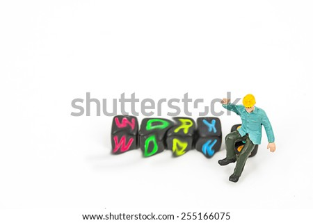 selective focus photo of miniature worker in blue suit standing on plastic toy on white background, abstract background to team work ,team building concept. - stock photo