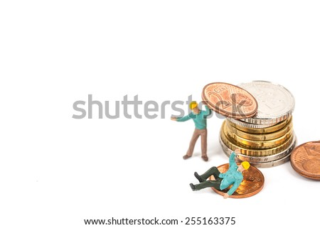 selective focus photo of miniature worker man sitting on 20 cent euro coins on white background, abstract background to money and saving concept. - stock photo