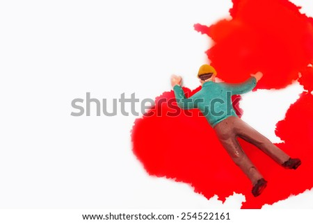 selective focus photo of miniature workers over blood background,abstract background for life insurance,safety first concept. - stock photo