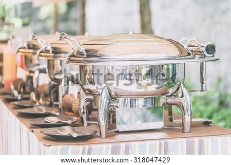 Selective focus point on Catering buffet food in restaurant - Light vintage filter effect - stock photo