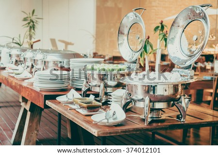 Selective focus point on Catering buffet in hotel restaurant - Vintage filter effect - stock photo