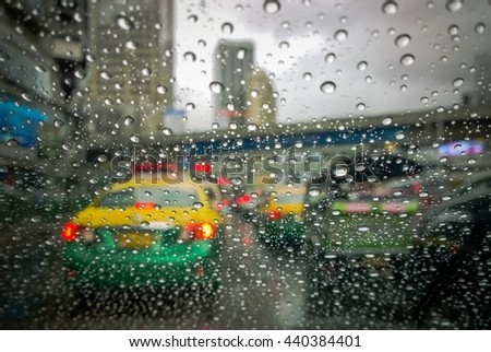 Selective focus, Rain Drops On The Glass Electric light In Background (raindrops,outdoor, traffic) - stock photo