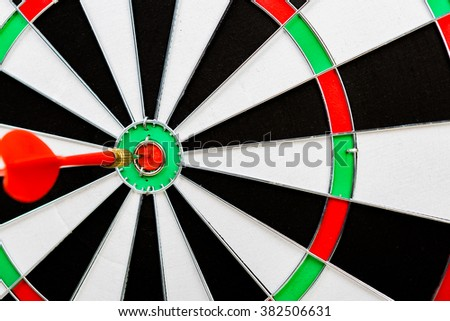 Selective Focus :  Red dart hit the target on dartboard