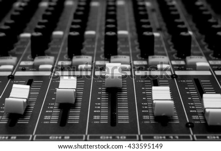 selective focus sound mixer musical equipment background. - stock photo