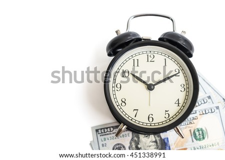 Selective focus, top view of black vintage antique alarm clock on dollar money cash isolated on white background - concept of time and financial management