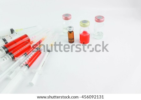 Selective focus vial and syringes with blurred background in the hospital. : medication,vaccine, drugs, blood, laboratory. Copy space.