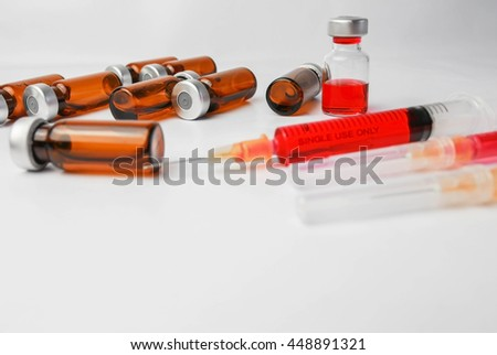Selective focus vials and syringes isolate on background : medication,vaccine, drugs, blood, laboratory. - stock photo