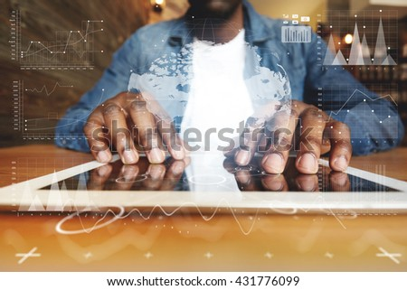 Selective focus. Visual effects. Worldwide connection technology interface. Close up shot of black man's hands touching screen of electronic device, browsing Internet on futuristic digital tablet - stock photo