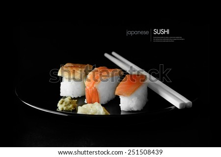 Selectively and creatively lit fresh Japanese Sushi with salmon and tuna on rice with wasabi and ginger relish. Dark background. Copy space.
