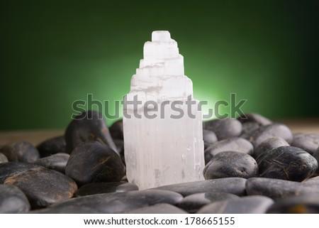 Selenite natural crystal mineral gypsum known as satin spar, desert rose, and gypsum flower  - stock photo
