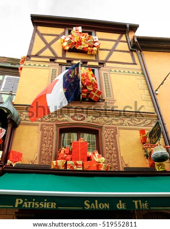 SELESTAT, FRANCE - DECEMBER 20, 2015: Christmas decoration with French flag at Selestat. Selestat with its beautiful painted houses is located on Alsace wine route and known as home of Christmas tree.
