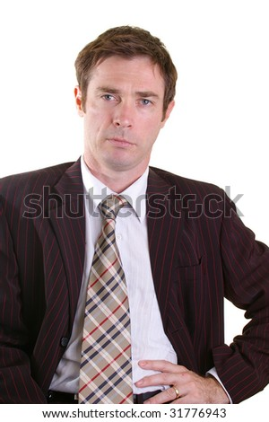 self assured business man taking a relaxed pose - stock photo