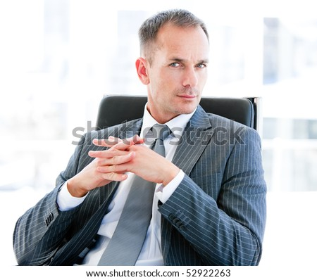 Self-assured businessman looking at the camera in the office